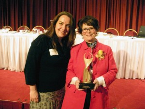 A stunned Ellen Foley thanks Rachel Rasmussen of the Business Forum for her nomination.